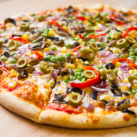 White pizza with green peppers, mushrooms, onions, tomatoes, black olives & broccoli
